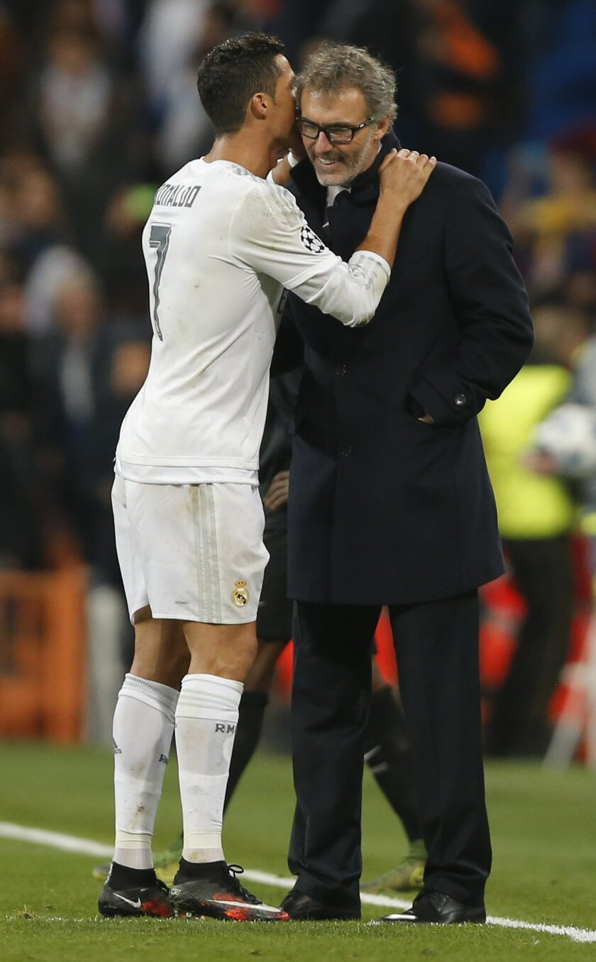 Real Madrid's Cristiano Ronaldo, left, talks with PSG headcoach Laurent Blanc after their Group stage of Champions League Group A soccer match at the Santiago Bernabeu stadium in Madrid, Spain, Tuesday, Nov.3, 2015. Ream Madridd won 1-0. (AP Photo/Daniel Ochoa de Olza)