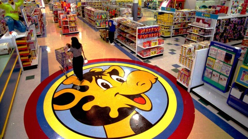 A floor decal at a Toys R Us store in 1996 shows the chain's mascot, Geoffrey the Giraffe.