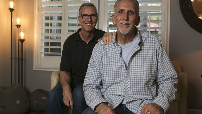 Craig Coley, right, with Mike Bender at Bender's house in Carlsbad on Tuesday.