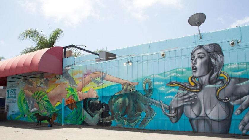 """The mural at 1st Street Bar in Encinitas is among 15 different images painted across the county to raise awareness about ocean environmental issues, in a project titled """"Sea Walls: Murals for Oceans."""" (COURTESY PHOTOS)"""