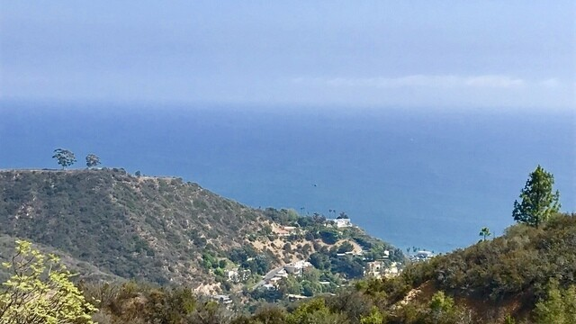 The unimproved ocean-view site in Malibu totals more than three acres.