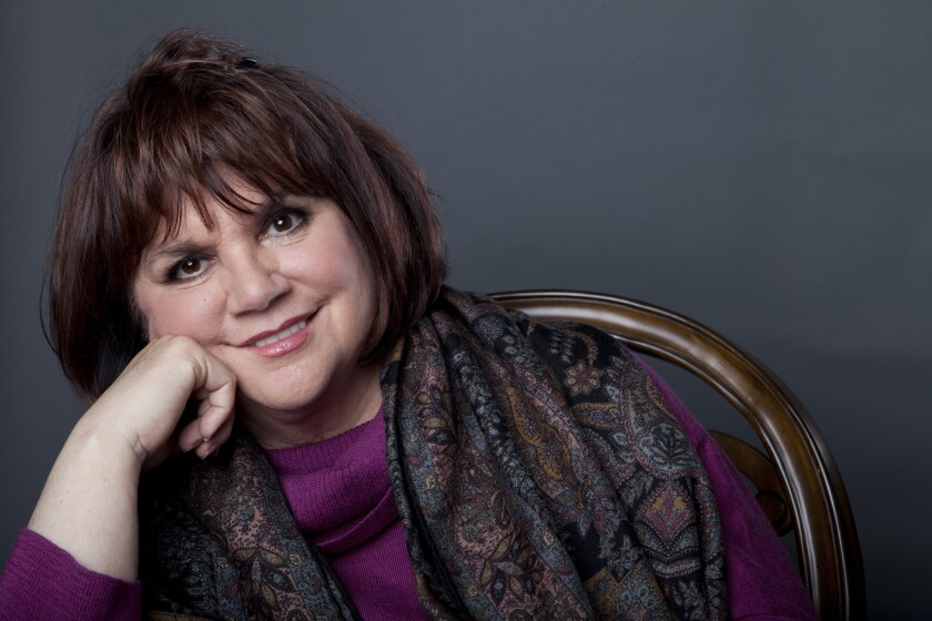 """FILE - In this Sept. 17, 2013 file photo, American musician Linda Ronstadt poses in New York to promote the release of her memoir """"Simple Dreams."""" Now at 74, the 10-time Grammy winner and Rock and Roll Hall of Famer has been recognized as a """"Legend"""" at the 33rd annual Hispanic Heritage Awards. (Photo by Amy Sussman/Invision/AP, File)"""