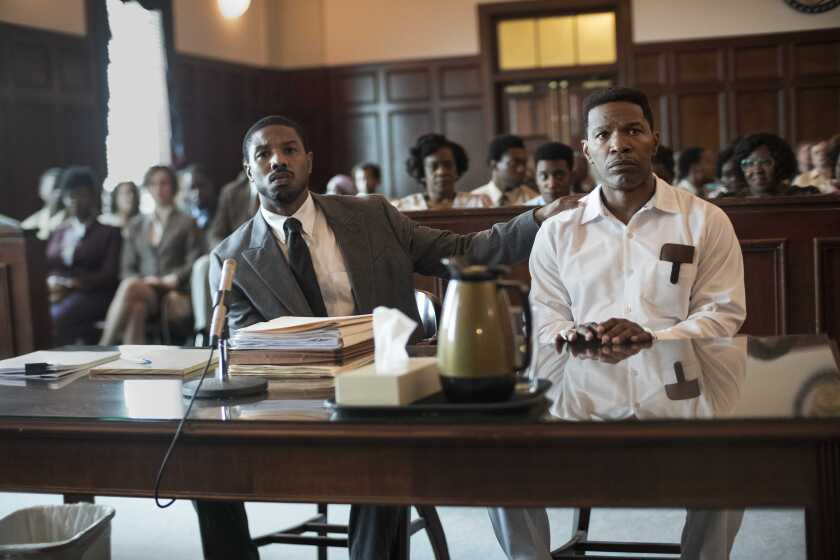 "Michael B. Jordan, left, as Bryan Stevenson and Jamie Foxx as death row inmate Walter McMillian in a courtroom scene in ""Just Mercy."""