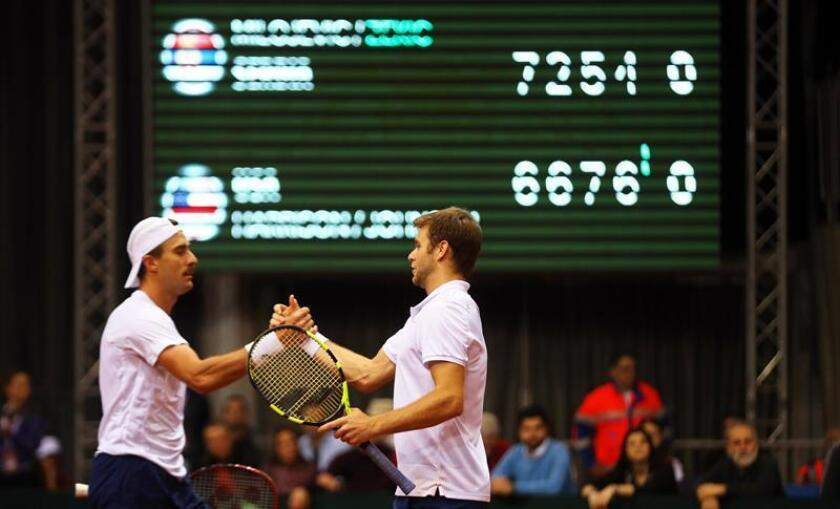 US players Steve Johnson (L) and Ryan Harrison (R) celebrate after defeating Serbian players Nikola Milojevic and Miljan Zekic in their doubles match of the Davis Cup World Group first round. EFE