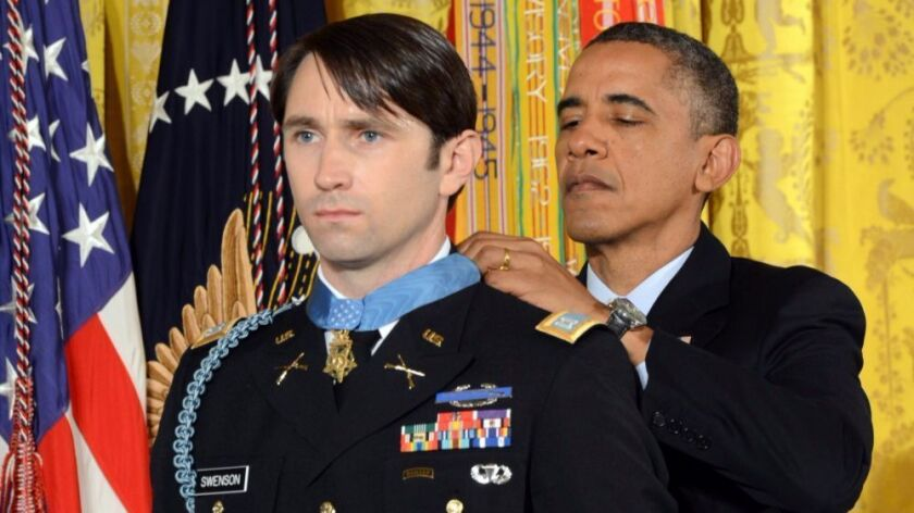Former President Barack Obama presents the Medal of Honor to Army Capt. William D. Swenson at the White House on Oct. 15, 2013.