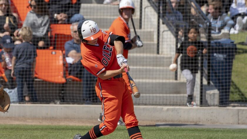 Huntington Beach's Jake Vogel, shown hitting a home run during the playoffs last spring, recently went four for four in a game.