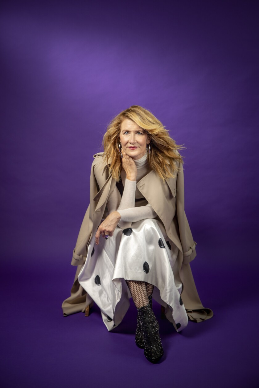 Laura Dern against a royal purple backdrop
