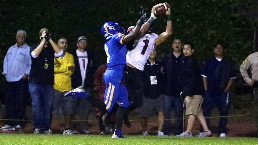 Oaks Christian wide receiver Michael Pittman catches the first of his five touchdown passes against Bishop Amat on Nov. 21.