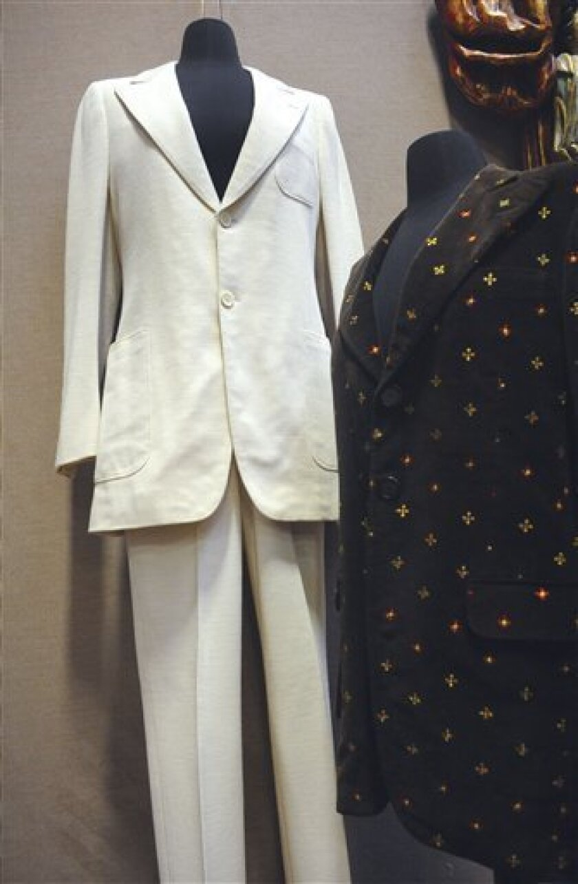 "FILE -- This Monday, Dec. 13, 2010 file photo shows the suit John Lennon wore in the photo on the cover of The Beatles' Abbey Road album, left, and a blazer he wore during his video for the song ""Imagine,"" at Braswell Galleries in Norwalk, Conn. The seller's former landlord has sued the gallery that auctioned the late Beatle's suit for $46,000, trying to get at the proceeds to satisfy a rent debt. (AP Photo/The Hour, Matthew Vinci, File) MANDATORY CREDIT"