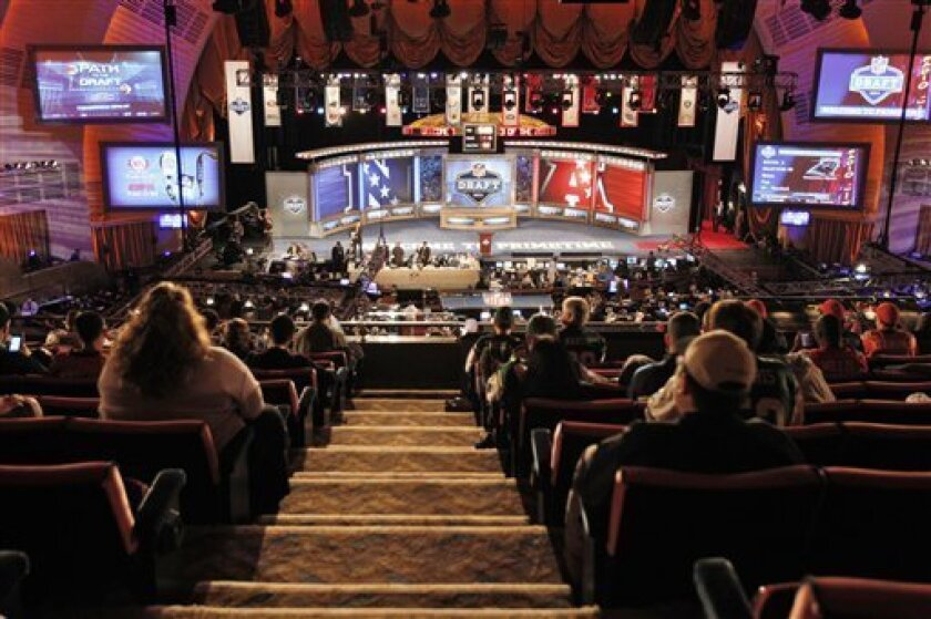 Fans look on during the fourth round of the NFL football draft by the at Radio City Music Hall Saturday, April 30, 2011, in New York. (AP Photo/Frank Franklin II)