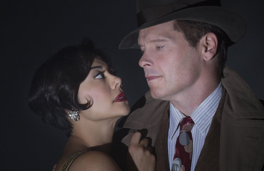 "Angel Desai and Michael Hayden in the Old Globe Theatre production of ""Double Indemnity."""