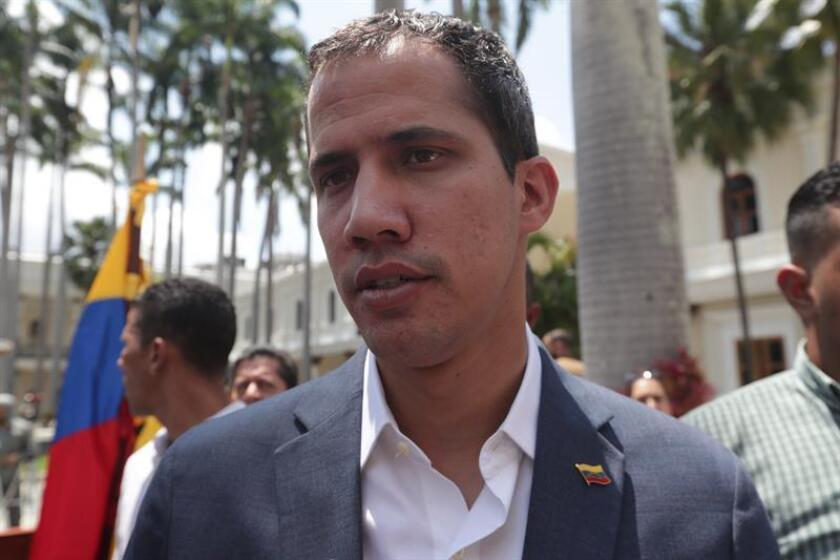 The head of the Parliament, Juan Guaido, speaks with reporters after holding a press conference at the Federal Legislative Palace in Caracas, Venezuela, 10 March 2019. EFE-EPA/ Rayner Pena