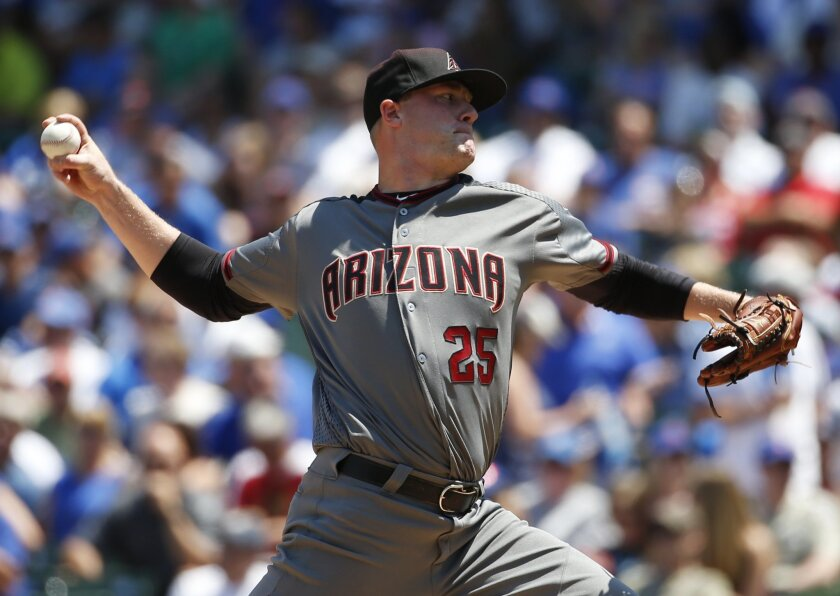 Arizona Diamondbacks starter Archie Bradley throws against the Chicago Cubs during the first inning of a baseball game Friday, June 3, 2016, in Chicago. (AP Photo/Nam Y. Huh)