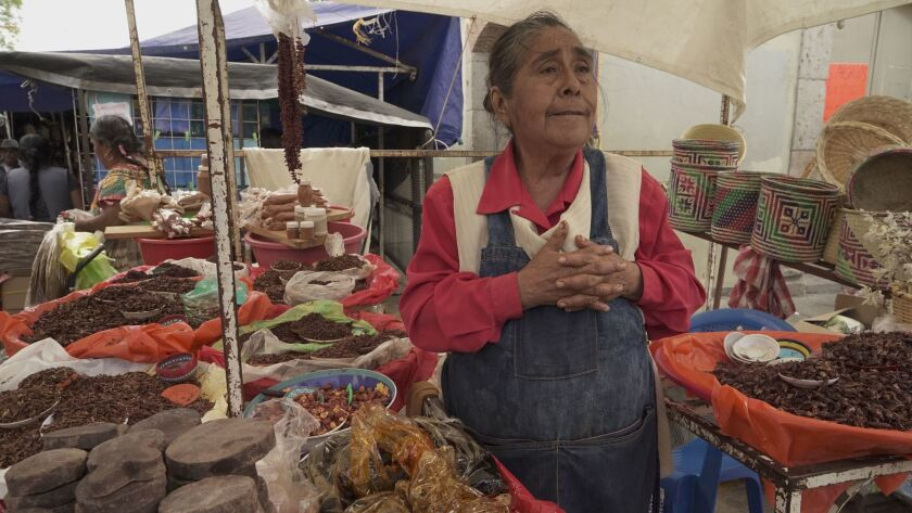 Eufenia Hernandez, 63, sells goods from her stall at the Sunday market in Tlacolula, Mexico.