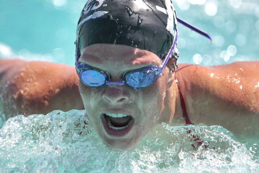 San Diego State swimmer Whitney Weisz competes in the 100 yard butterfly during the Aztecs swim meet against USD at SDSU in San Diego on Friday.