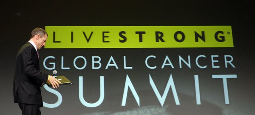 Lance Armstrong arrives to open the Livestrong Global Cancer Summit in Dublin, Ireland.