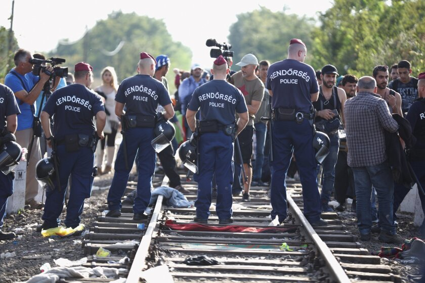 Hungarian police block the track at the Hungarian-Serbian border on Monday, preventing migrants from crossing.