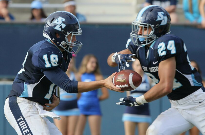 USD QB Anthony Lawrence hands off to Blake Martin.