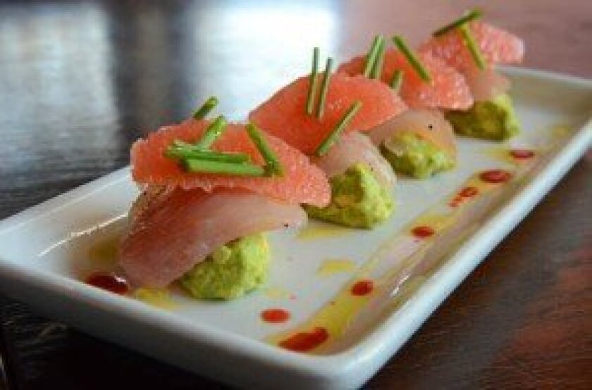Albacore Tuna Crudo with Hass avocado, ruby grapefruit and lemon olive oil.