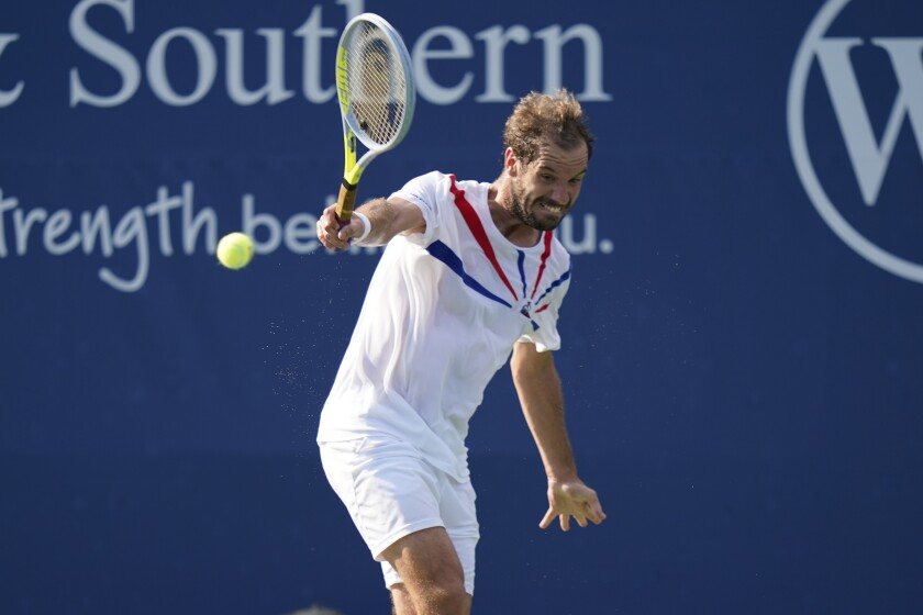 Richard Gasquet, of France, returns a shot against Roberto Bautista Agut, of Spain, during the second round at the Western & Southern Open tennis tournament Monday, Aug. 24, 2020, in New York. (AP Photo/Frank Franklin II)