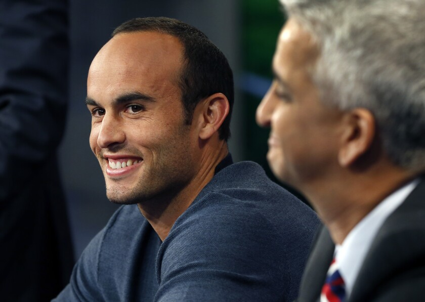 Landon Donovan, left, speaks about his retirement from soccer next to Sunil Gulati, president of the U.S. Soccer Federation, during a press conference Friday in Bristol, Conn.