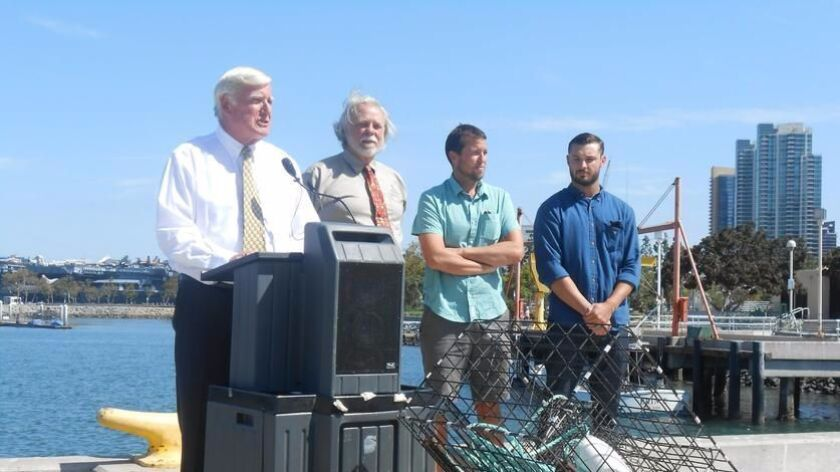 Bob Nelson, second from left, at an event on San Diego's waterfront