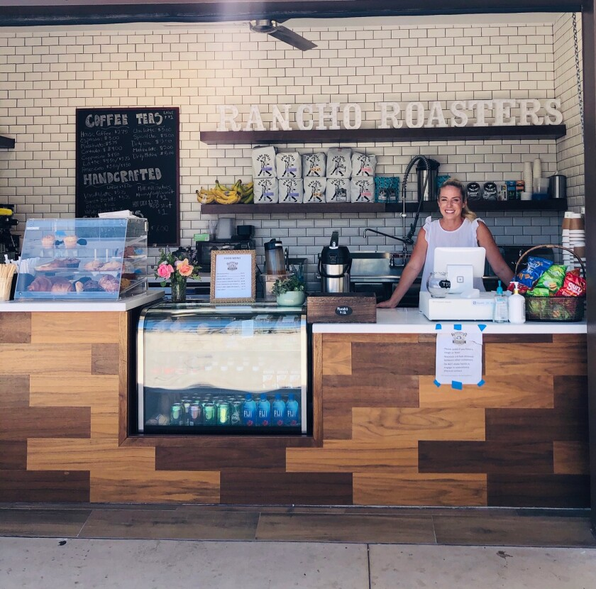 Courtney Cindrich opened the new Rancho Roasters coffee shop in the village.