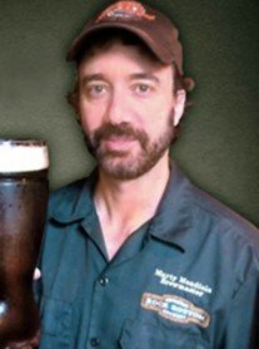 Marty Mendiola, brewmaster at Rock Bottom's La Jolla location, wins three medals at the 2013 Great American Beer Festival.