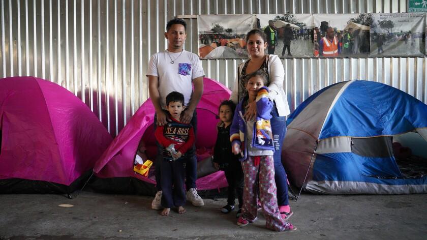 David Enamorado, 32, from Honduras shares a small tent with his family at the Movimiento Juventud sh