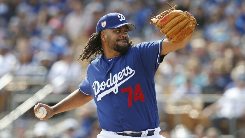Dodgers pitcher Kenley Jansen throws during a spring training game against the Seattle Mariners on March 9, 2019, in Phoenix.