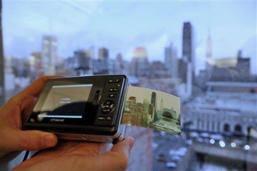 The Polaroid Zinc instant print camera is demonstrated Thursday Dec. 31, 2008 in New York. (AP Photo/Bebeto Matthews)