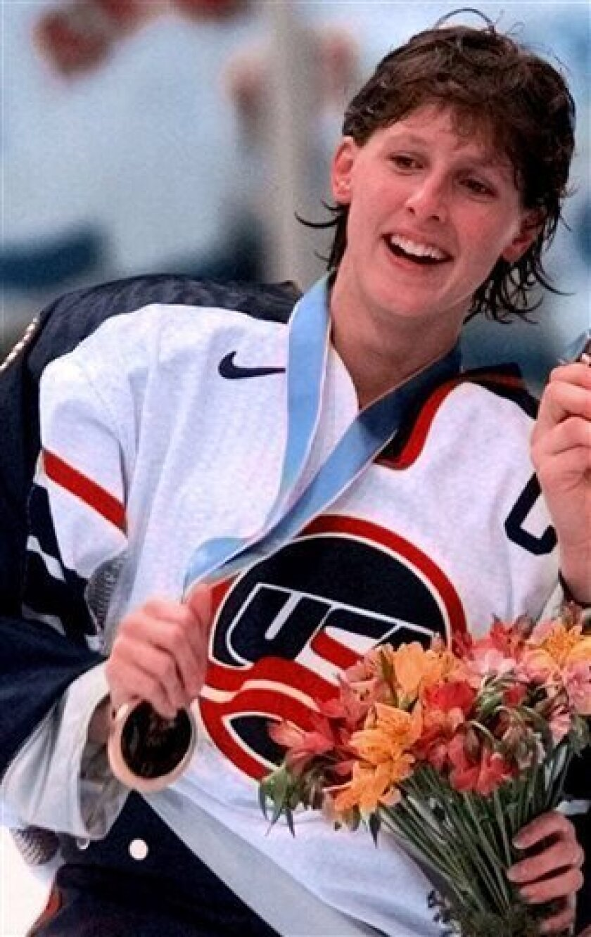 FILE - In this Feb. 17, 1998, file photo, United States Olympic women's hockey player Cammi Granato displays her gold medal during the medal presentations following the team's win over Team Canada in the gold medal game at the Olympics in Nagano, Japan. Granato was elected to the Hockey Hall of Fame on Tuesday, June 22, 2010. (AP Photo/Kevork Djansezian, File)