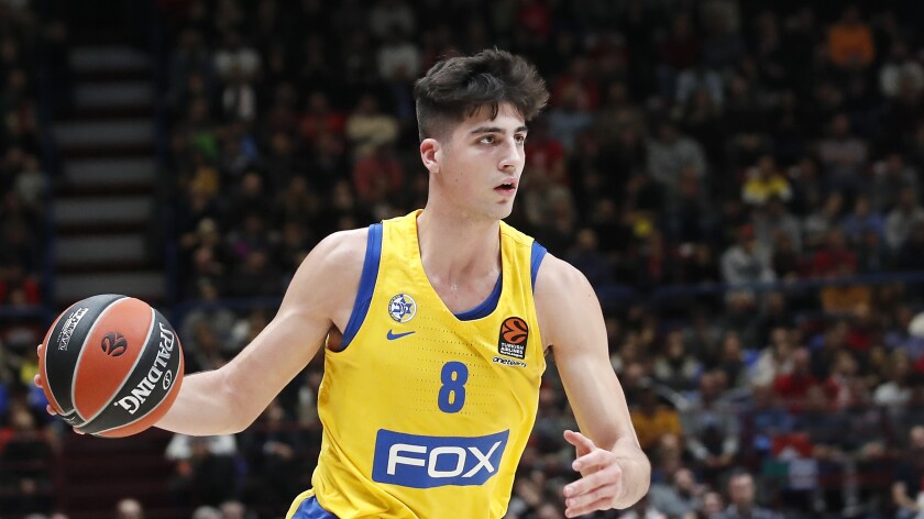 Deni Avdija brings the ball up court for Maccabi Fox Tel Aviv in a Euroleague game against Olimpia Milan on Nov. 19, 2019.