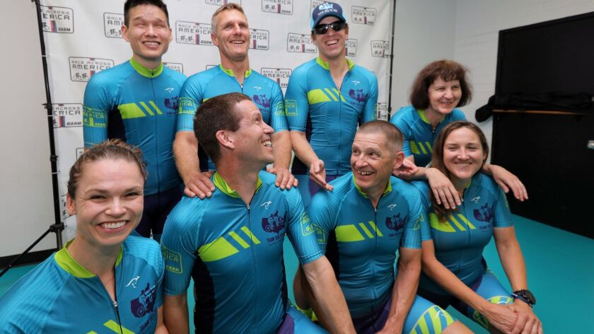 """Members of Race Across America's tandem cycling Team Sea to See. Four sighted pilots, front row from left, Caroline Gaynor, Charles Scott, Chris Howard and Pamela Ferguson, will ride with blind """"stokers,"""" back row from left: Jack Chen, Dan Berlin, Kyle Coon and Tina Ament."""