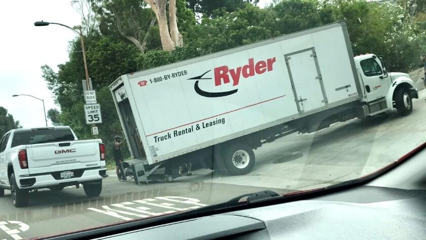 A truck gets stuck heading up Hillside Drive in La Jolla from Torrey Pines Road in July.