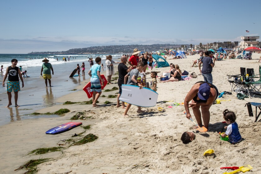 Crowds gathered at Mission Beach on June 26th, 2020 in San Diego, California.