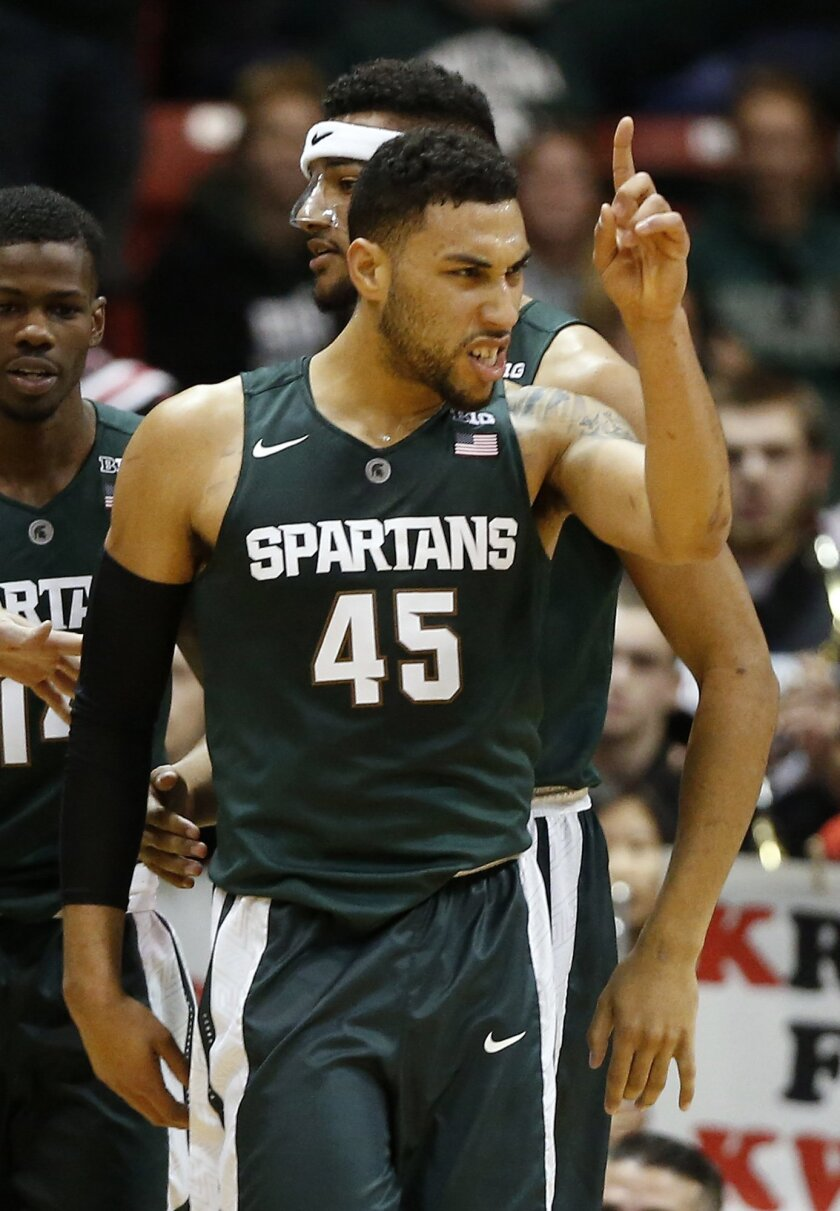 FILE - In this Dec. 19, 2015, file photo, Michigan State's Denzel Valentine reacts after sinking a basket against Northeastern during the second half of a NCAA college basketball game in Boston. Valentine was selected to the AP All-America men's college basketball team, Tuesday, March 29, 2016. (AP Photo/Winslow Townson, File)