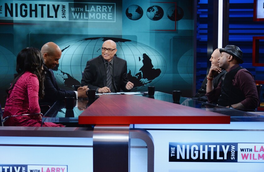 "From left, Shenaz Treasury, Sen. Cory Booker (D-N.J.), host Larry Wilmore, Bill Burr and Talib Kweli appear in the first episode of ""The Nightly Show"" on Monday."