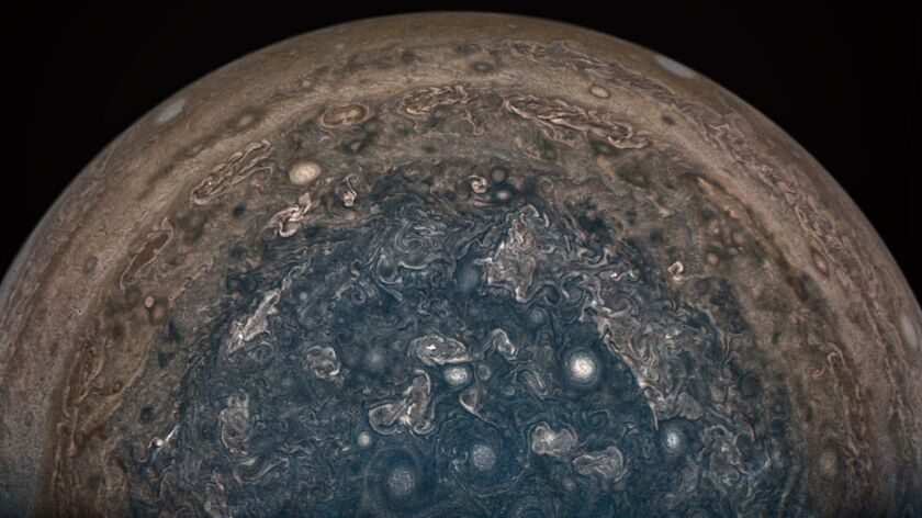 NASA's Juno spacecraft took this picture of Jupiter's south pole and its marbled atmosphere from about 62,800 miles above the cloud tops. NASA said Friday the craft will remain in its oblong orbit for the duration of its mission.