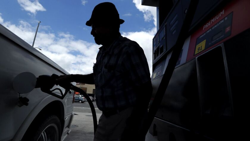 VAN NUYS, CA-MAY 25, 2018: David Micciche of Van Nuys fills up the tank on his Ford Lobo Extra Cab