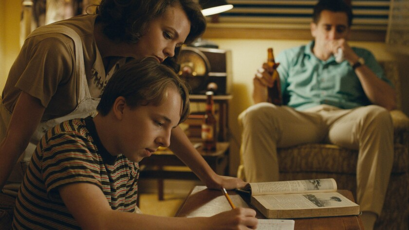 """(L-R) - Carey Mulligan, Ed Oxenbould and Jake Gyllenhaal appear in """"Wildlife"""" by Paul Dano, an offic"""