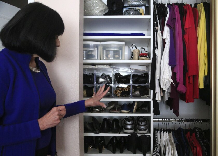 Donna Dotson's sliding-door poses storage challenges so her strategy is to divide items on various shelves, and using bags and containers to keep things dust-free. Pictures offer quick reference to what's inside.