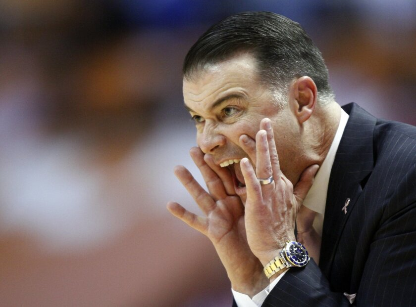 Kentucky head coach Matthew Mitchell yells to his players in the first half of an NCAA college basketball game against Tennessee, Sunday, Feb. 16, 2014, in Knoxville, Tenn. (AP Photo/Wade Payne)