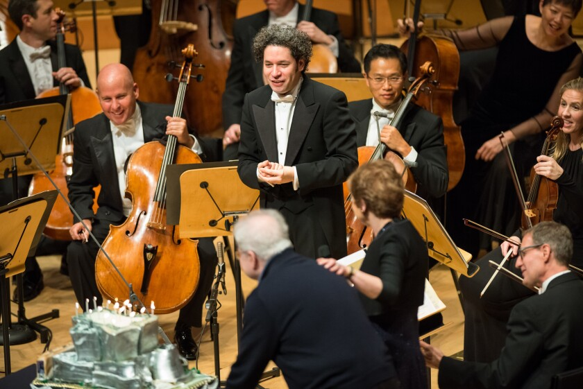Pianist Emanuel Ax rolls out a cake for Gustavo Dudamel's 36th birthday following the the Los Angeles Philharmonic performance at the Walt Disney Concert Hall on Thursday night