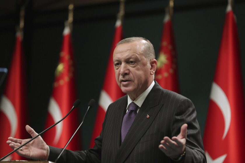 Turkey's President Recep Tayyip Erdogan speaks after a cabinet meeting, in Ankara, Turkey, Monday, Dec. 14, 2020. Erdogan has announced a four-day lockdown starting New Year's eve to curb the spread of COVID-19. Erdogan said the curfew would begin the evening of Dec. 31 and go on until the morning of Jan. 4. (Turkish Presidency via AP, Pool)