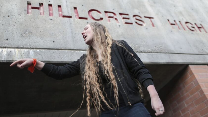 Hillcrest High School junior Kylee Denny addresses classmates as they participate in a walkout to protest gun violence on Wednesday, March 14, 2018, in Idaho Falls, Idaho, one month after the deadly shooting inside a high school in Parkland, Fla.