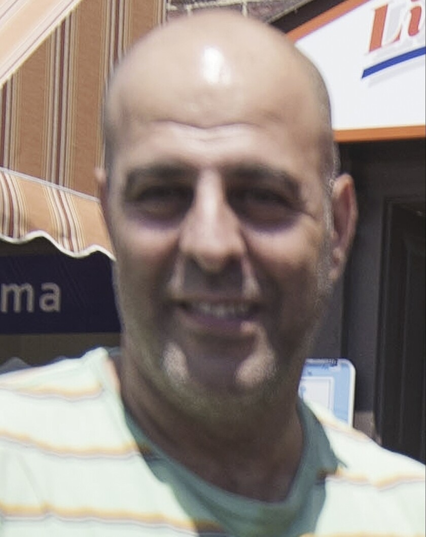 FILE - This photo taken July 5, 2016, shows Amer Fakhoury, owner of Little Lebanon To Go restaurant in Dover, N.H. Fakhoury, an American who was jailed for months in Lebanon and later released over decades-old murder and torture charges that he denied, died Monday, Aug. 17, 2020, his family said. He was 57. Fakhoury, a restaurant owner in Dover, New Hampshire, died at the Dana-Farber Cancer Institute in Boston. He had been diagnosed with State 4 lymphoma while in prison. (John Huff/Foster's Daily Democrat via AP, File)