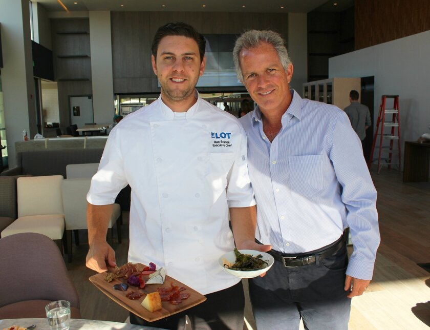 The Lot executive chef Matt Sramek and owner Adolfo Fastlicht with some of the dishes Sramek has created for The Lot's bar, restaurant and in-theater food-service menus.