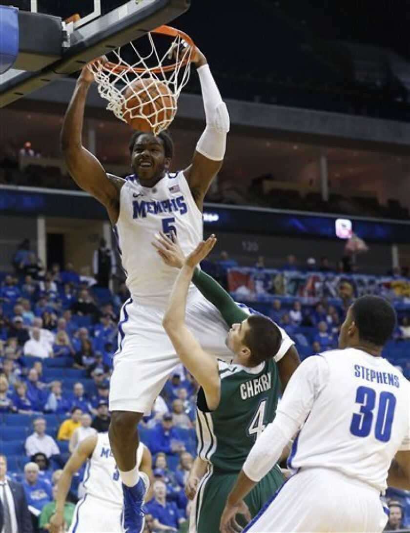 Memphis forward Shaq Goodwin (5) dunks over Tulane guard Ben Cherry (4) in the first half of a men's NCAA college basketball game in the Conference USA tournament in Tulsa, Okla., Thursday, March 14, 2013. Memphis forward D.J. Stephens (30) watches the play. (AP Photo/Sue Ogrocki)