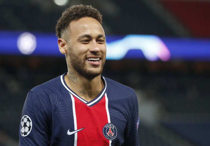 PSG's Neymar smiles during the Champions League